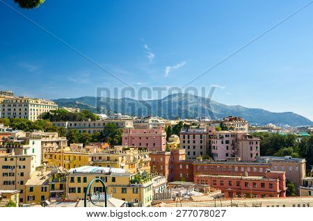 Colorful Buildings On Hill In City District Of Genoa Genova And Monte Fasce Mountain Of Ligurian App
