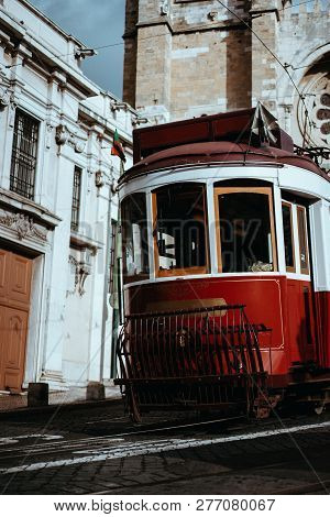 Quaint Tram Passes Directly In Front Of The Se Cathedral In Lisbon. Lisboa Lissabon