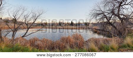 Iews Of Joshs Pond Walking Path, Reflecting Sunset In Broomfield Colorado Surrounded By Cattails, Pl