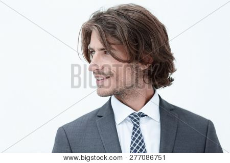 Handsome man in stylish clothes is looking away and smiling