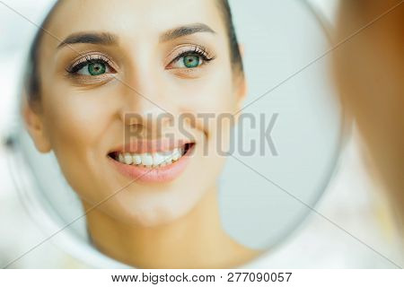 Health And Beauty. Beautiful Young Girl With Clean Skin Looking In The Mirror. Beauty And Care. Port