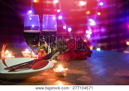 Valentines Dinner Romantic Love Concept - Romantic Table Setting Decorated With Red Heart Fork Spoon