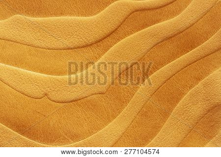 Texture Of Golden Yellow Genuine Leather Close-up, With Stamped Pattern, Wallpaper Or Banner Design