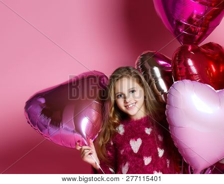 Beautiful Little Girl Celebrating Birthday Party With Big Pink Heart Balls. Family Celebration Of Th