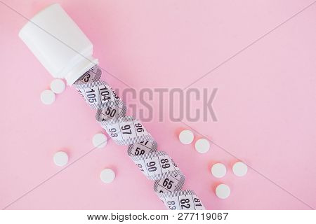 Close Up Of Pills. Dietary Supplements. Variety Pills. Vitamin Capsules On Pink Background