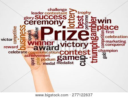 Prize Word Cloud And Hand With Marker Concept