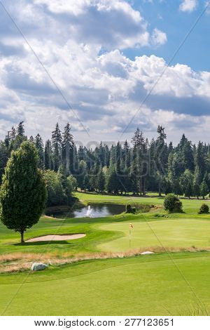 Golf course with gorgeous green and fantastic pond view