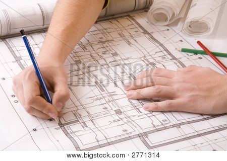 Engineer Working On The Home Plan To Office
