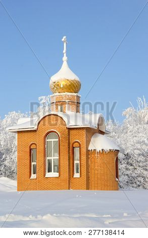 Winter Landscape With A Chapel. Sunny Day