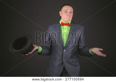 Confused Man With A Bowler Hat Is Spreading His Hand And Is Shrugging Shoulders To Show That He Do N
