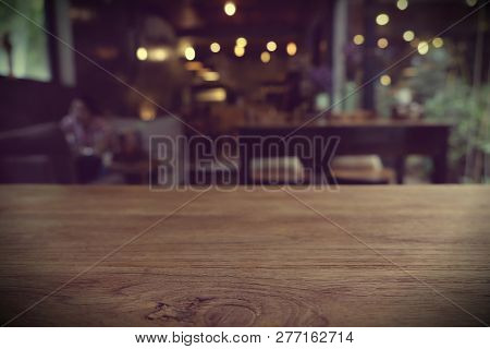 Top Of Empty Wood Table With Bar Cafe Restaurant Blurred Backgro