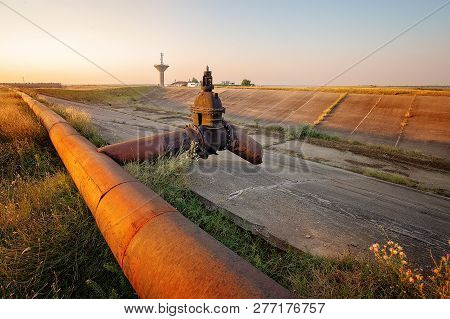 Draganesti-olt/romania - 29 August 2015: Rusty Pipes And Abandoned Irrigation Infrastructure In The