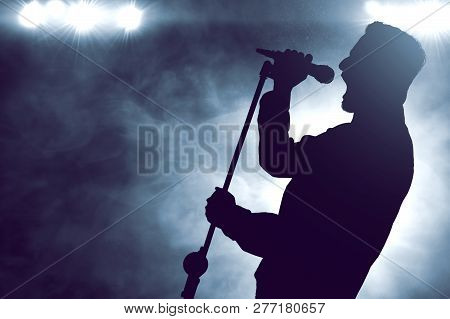 Singer Singing With Microphone On The Stage Silhouette