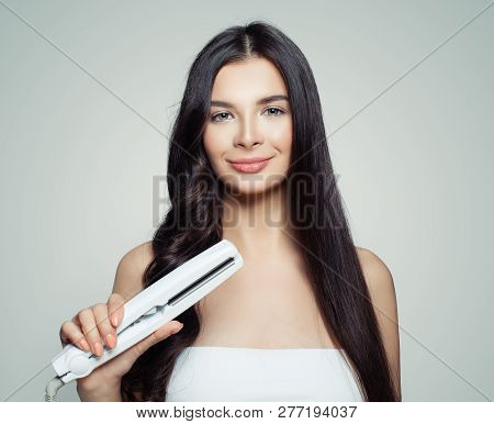 Beautiful Woman With Straight Hair And Curly Hair Using Hair Straightener. Cute Girl Straightening H