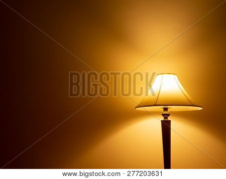 Modern Lamp With Orange Light And Wall Background. Creative Idea, Inspiration, New Idea And Innovati