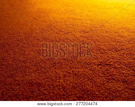 Orange Carpet Rug Texture On Floor With Yellow Light For Background Wallpaper (selective Focus)