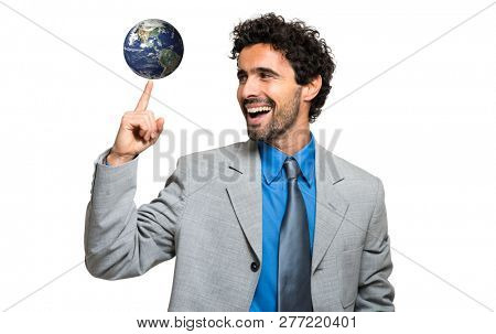 Manager holding the planet on his finger