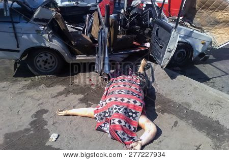 Kharkov, Ukraine - June 18, 2010: The Dead Person As A Result Of A Car Accident, The Corpse Of A Per