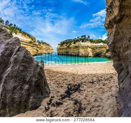 Beautiful beach  in ocean fjord of Pacific ocean. The Great Ocean Road of Australia. The concept of exotic, active and photo-tourism