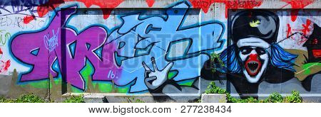 The Texture Of The Wall With Graffiti, Which Is Depicted On It. The Image Of The Whole And Complete