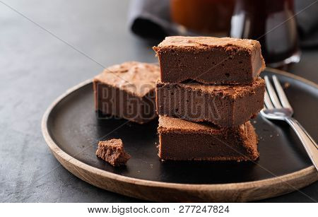 Double Chocolate Brownies. Homemade Chocolate Fudge Brownies With Chocolate Chips And Black Backgrou