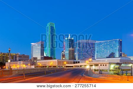 Downtown Dallas Skyline At Night With Illuminated Glass Buildings Seen From Houston Street