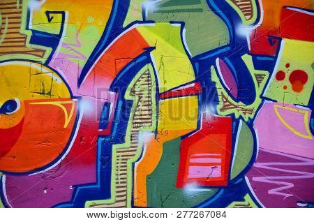 Background Image With Graffiti Elements. Texture Of The Wall, Painted In Different Colors Of In The