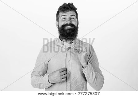 Fashion And Dress Code Concept. Man Holding Paper Party Props Bow Tie, White Background. Hipster Wit