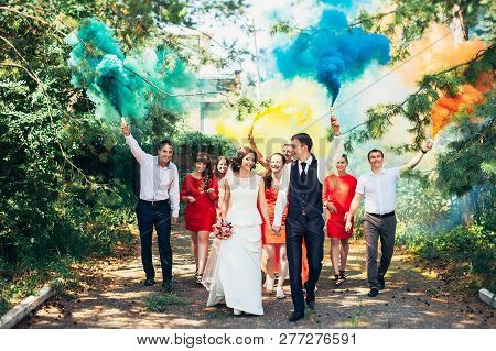 Russia, Orenburg  - July 29, 2017:  Wedding guests. Bride and groom kissing at wedding ceremony. Funny guests at the wedding. Bride, groom and guests outdoors. Wedding day. Photo session