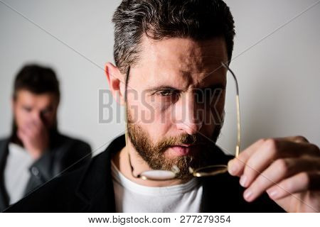 Now I See Everything. Attentive Glance. Picky Smart Inspector. Man Handsome Bearded Guy Wear Eyeglas