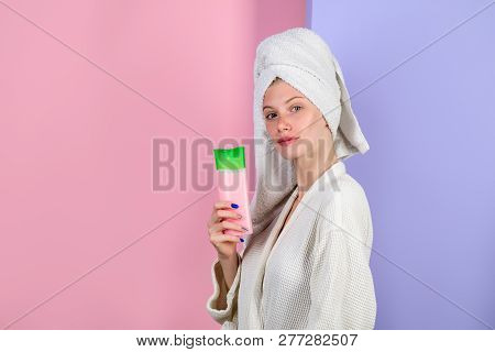 Woman In White Tender Bathrobe. Haircare. Woman With Shampoo Bottle. Shampoo. Shower. Morning Treatm