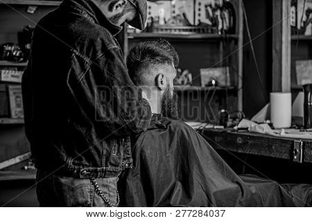 Hairstyle Service Concept. Barber With Clipper Works On Hairstyle For Bearded Man, Barbershop Backgr