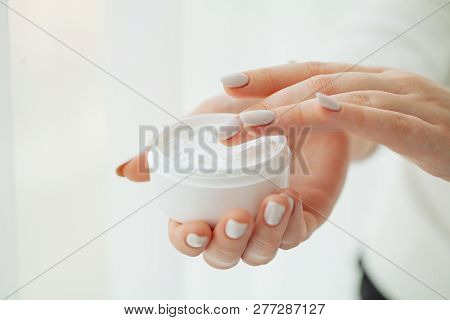 Hand Skin Care. Close Up Of Female Hands Holding Cream Tube, Beautiful Woman Hands With Natural Mani