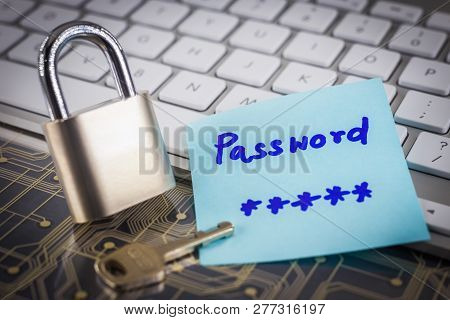 Padlock Key And Secret Password Note On White Keyboard And Electronic Circuit Board. Digital Data Di