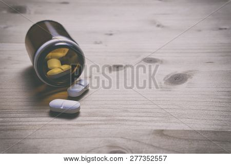Painkillers. Opioid Epidemic And Drug Abuse Concept With Close Up On A Bottle Of Prescription Drugs.