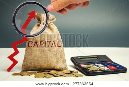 Money Bag With The Word Capital And An Up Arrow. The Concept Of Accumulation And Increase In Money C