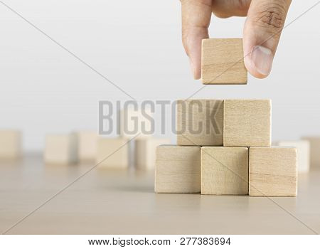 Hand Arranging Wooden Blocks Stacking As A Pyramid Staircase On White Background. Success, Growth, W