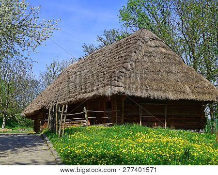 Vacation In The Country. Traditional Log Hut. Old House On Spring Landscape. Village Cottage. Buildi