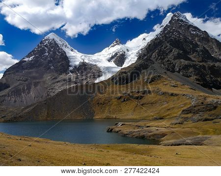 The Ausangate Trail With His Stunning Views On High Mountains And Blue Lakes