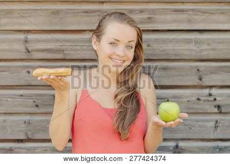 Happy Summertime. Young Beautiful And Smiling Woman. Fruit Versus Pastry.