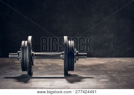 Fitness Dumbbells Weights Equipment Selective Focus Fitness Club.