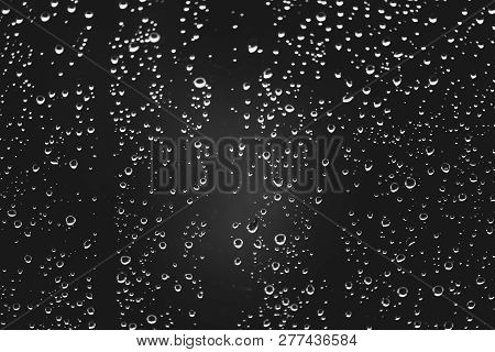 Dirty Window Glass With Drops Of Rain. Atmospheric Monochrome Dark Background With Raindrops. Drople