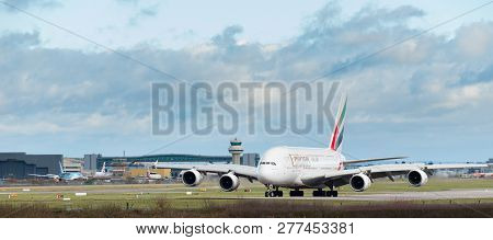 Gatwick Airport, England, Uk - December 09 2018: An Emirates Airline A380 Airbus Taxis After Landing