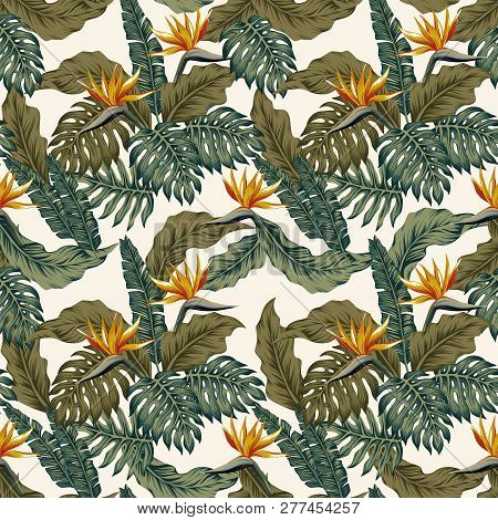 Tropical green palm leaves, monstera and exotic flowers bird of paradise (strelizia) seamless vector pattern on the white background poster