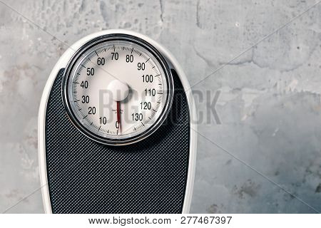 Bathroom Scale Isolated On Grey Background Close Up.