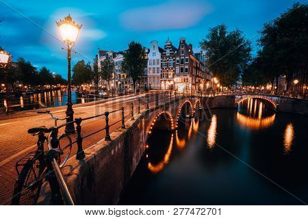 Night Cityview Of Famous Keizersgracht Emperors Canal In Amsterdam, Tranquil Scene With Street Lante