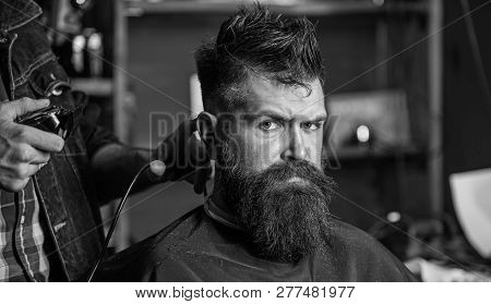 Barbers Hand With Hair Clipper Trimming. Stylish Haircut Concept. Hands Of Barber With Clipper Close