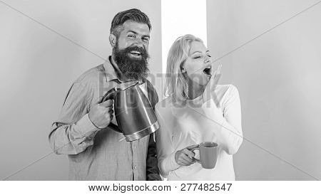 Enjoying Morning Coffee. Man With Electric Teapot And Woman With Mug Ready To Drink Morning Coffee.
