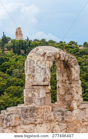 Athens, Greece - June 12, 2013: Acropolis Stone Arch With The View On Famous Monument Of Philopappos