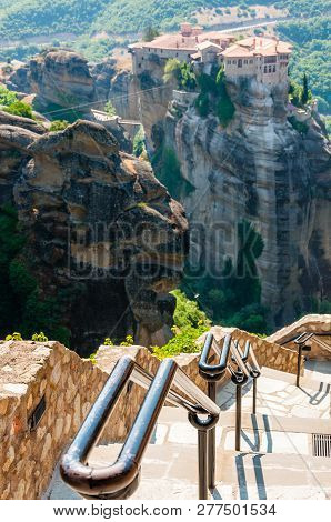 Meteora, Greece - June 16, 2013: Panoramic View From Meteoron Monastery Cliff Stone Stairs With Meta